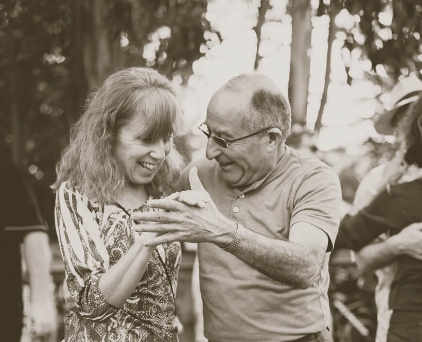 Senior man and woman dance in black and white