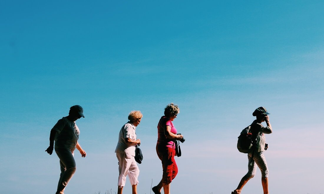 four seniors on a hike